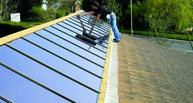 Applying solar window film to the roof glass of a school in Clyst St Mary Exeter Devon Tinting Express Ltd Barnstaple