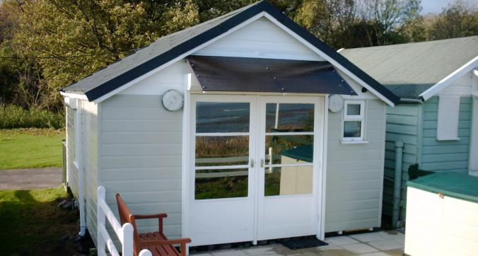Beach hut with Solar Neutral 20 window film applied to door windows Dunster Beach Minehead Somerset
