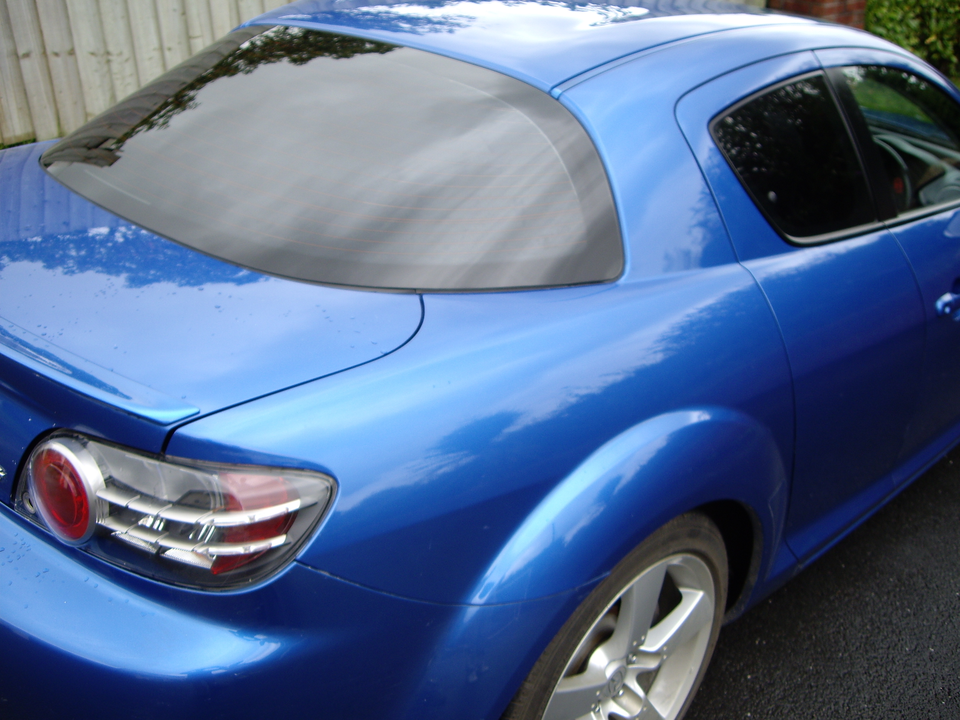 Mazda RX8 limo tint window film application Tinting Express Ltd