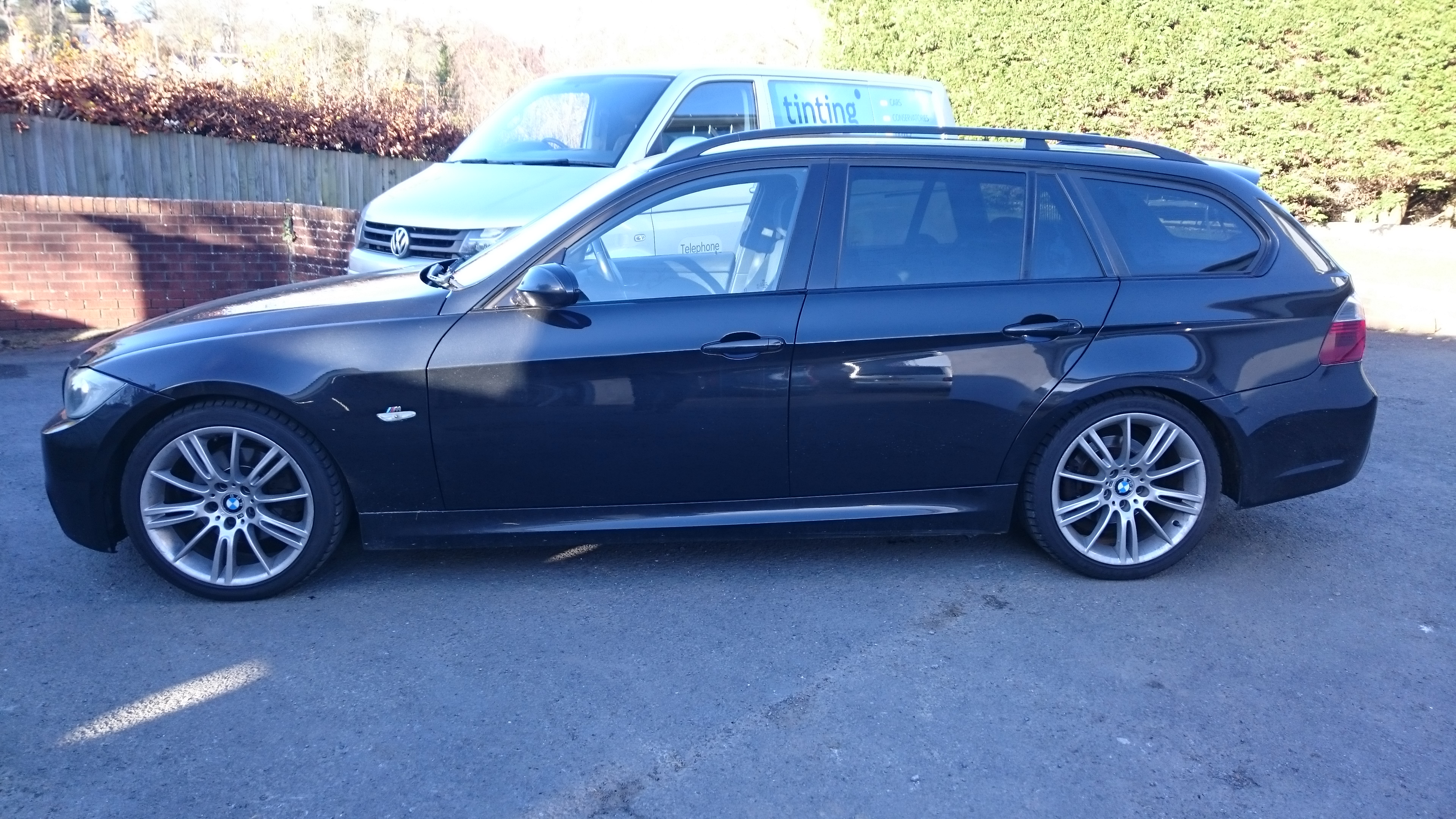 BMW 3 Series estate 20% vlt in bright sunlight looks lighter . Tinting Express