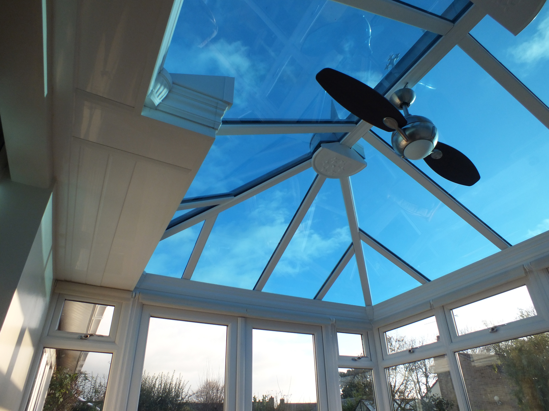 Conservatory roof glass fitted with blue 25 solar window film for glare issues Tinting Express Ltd Barnstaple UK