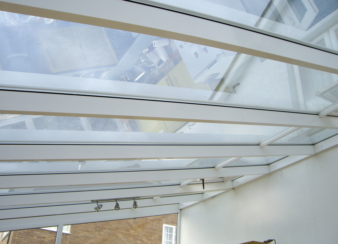 Silver 20 solar window film applied to a large lean-to style conservatory roof Tinting Express Barnstaple Devon
