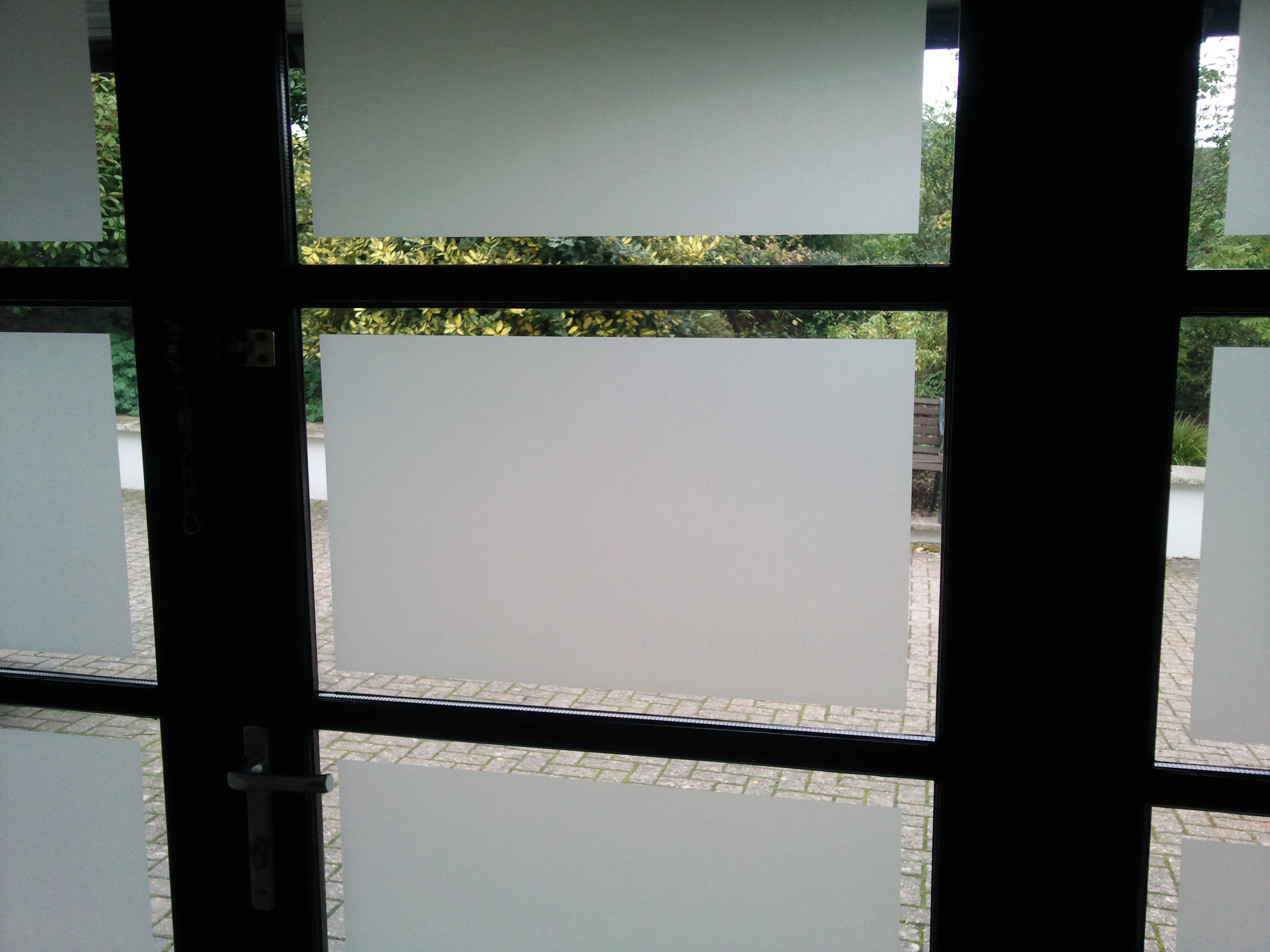 Frosted window film application to doors in Tiverton Devon Tinting Express Ltd