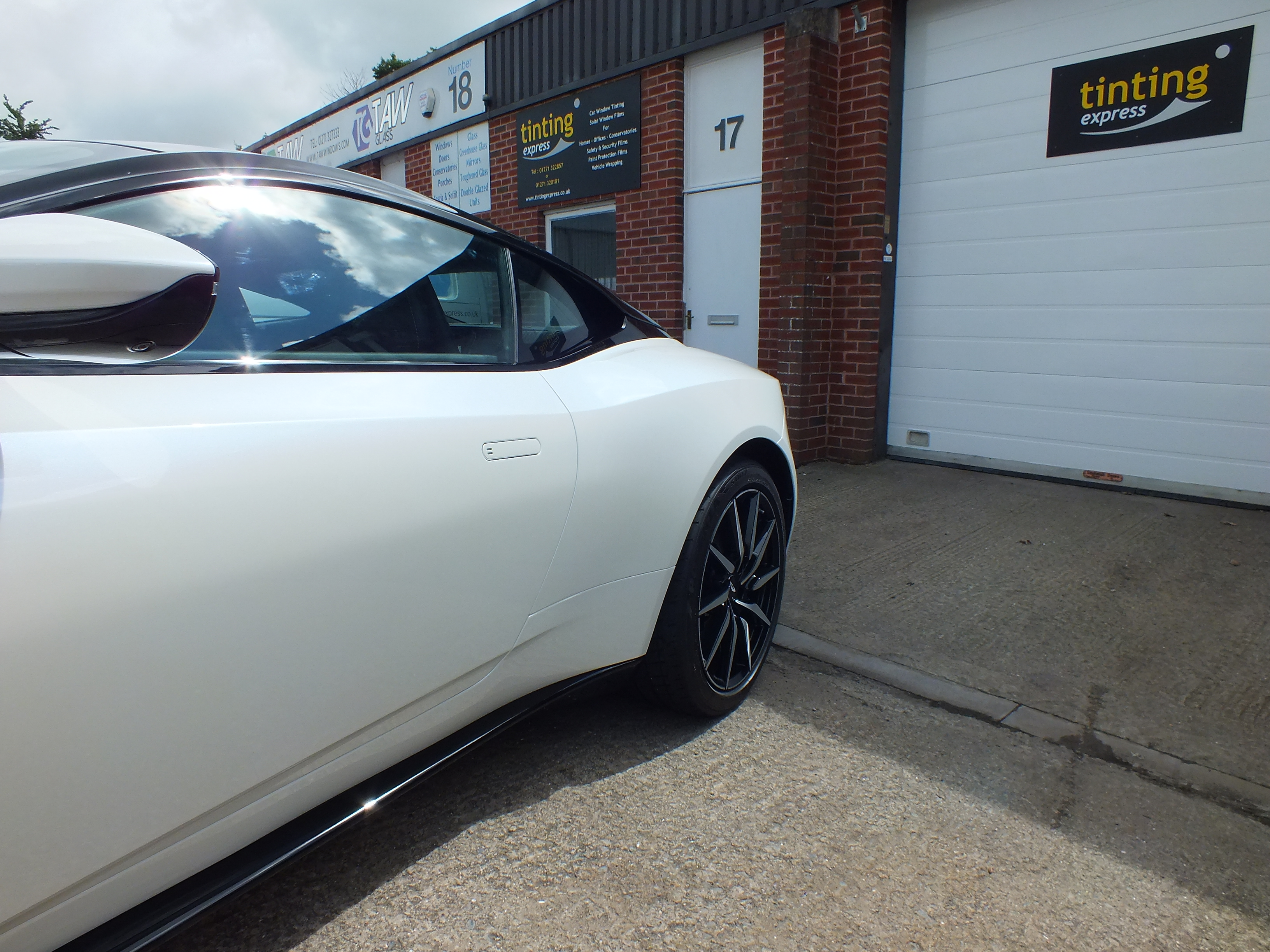 Paint Protection Film application completed on this Aston Martin DB11 by Tinting Express Ltd