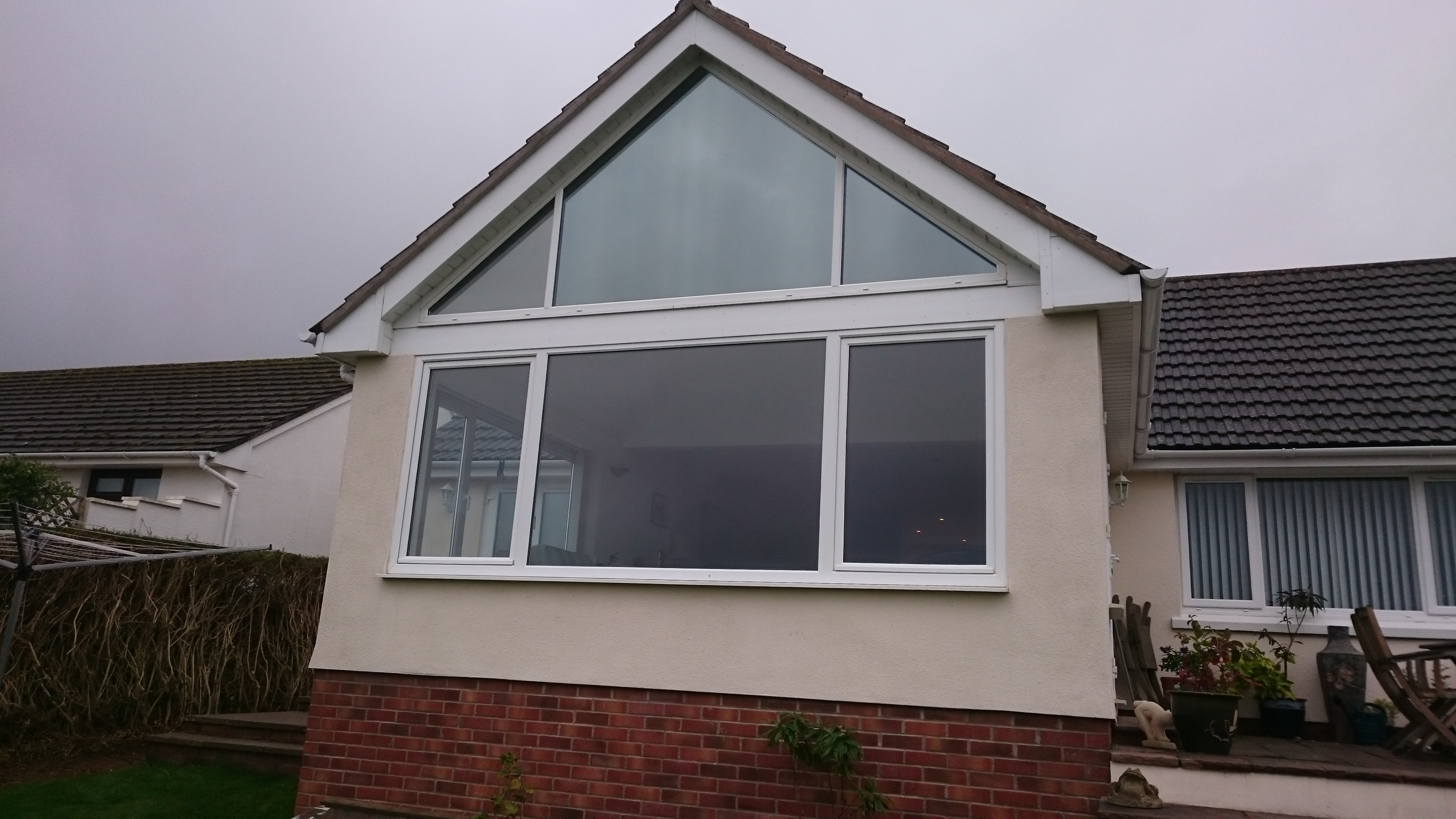 Final finished look from the outside. Gable end window Dual 30 reflective solar window film. Tinting Express Barnstaple