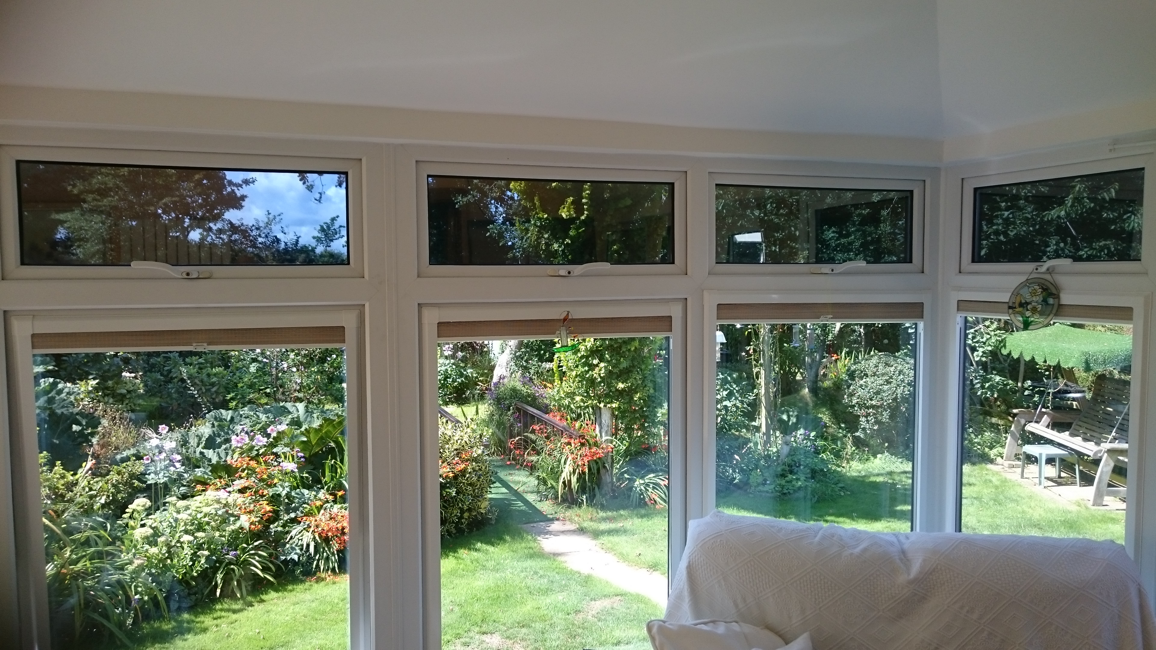 Opening vent windows in a conservatory fitted with Dual 15 solar window film to help reduce glare. Yelland Barnstaple by Tinting Express