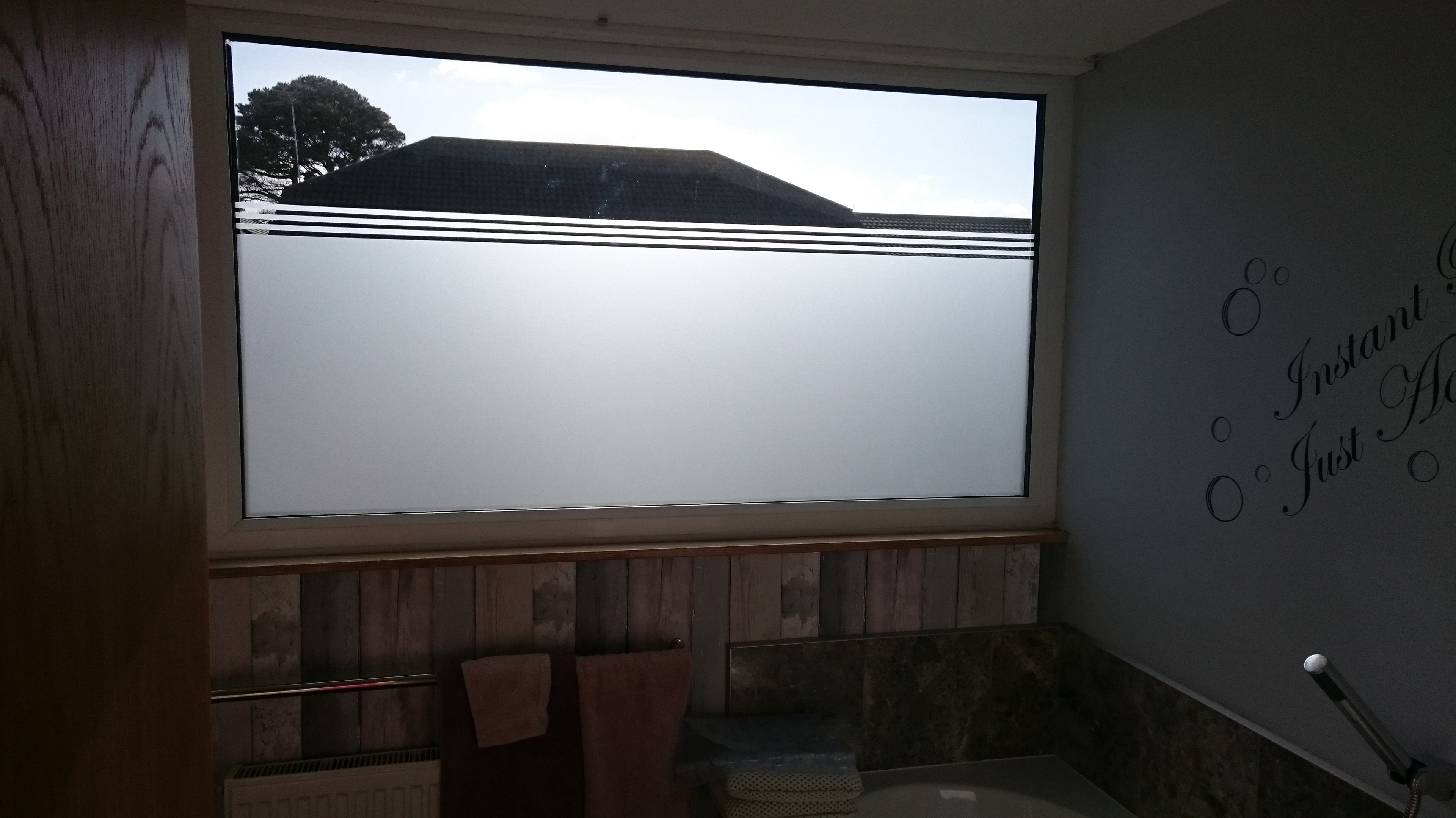 Frost film application to a bathroom window in Northam Bideford North Devon by Tinting Express Barnstaple