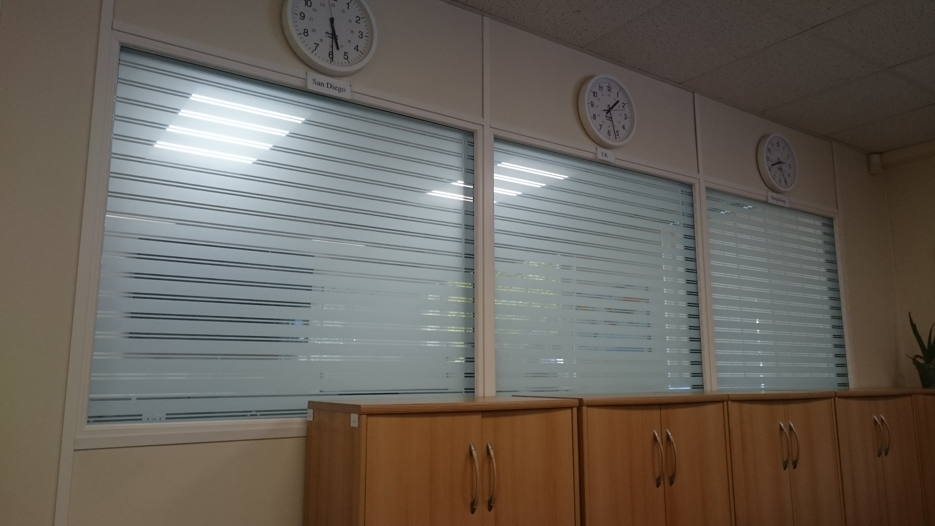 Frosted lines to diminish the view into the meeting room in Ilfracombe . Tinting Express Devon