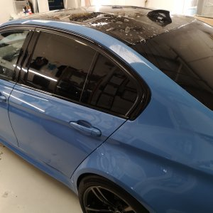 Blue BMW M3 saloon having its carbon roof protected with ppf film. Fitted by our trained Tinting Express fitters in Barnstaple, Devon