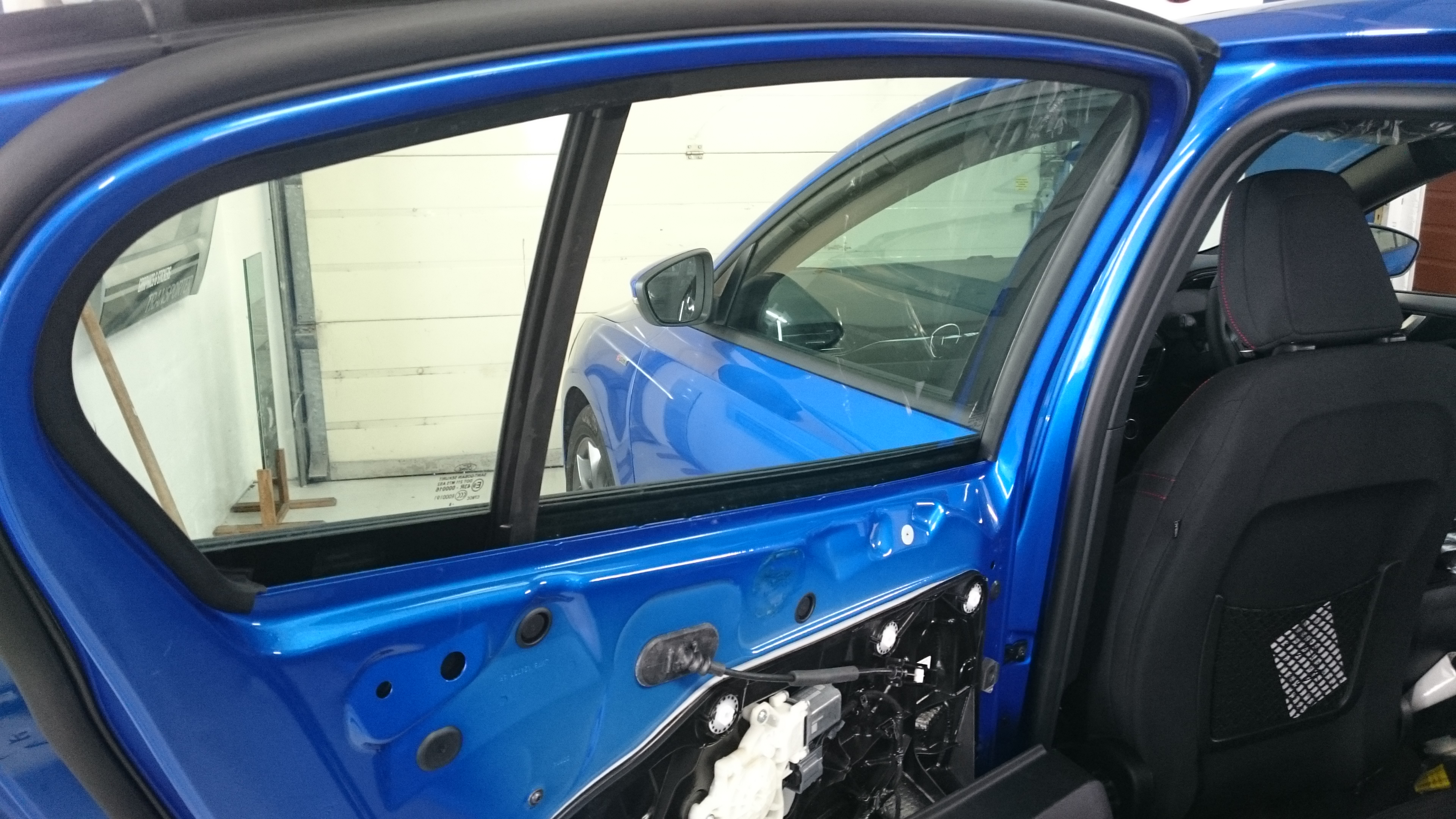 Ford Focus 5 door hatchback door area ready to have window film applied. Tinting Express Barnstaple