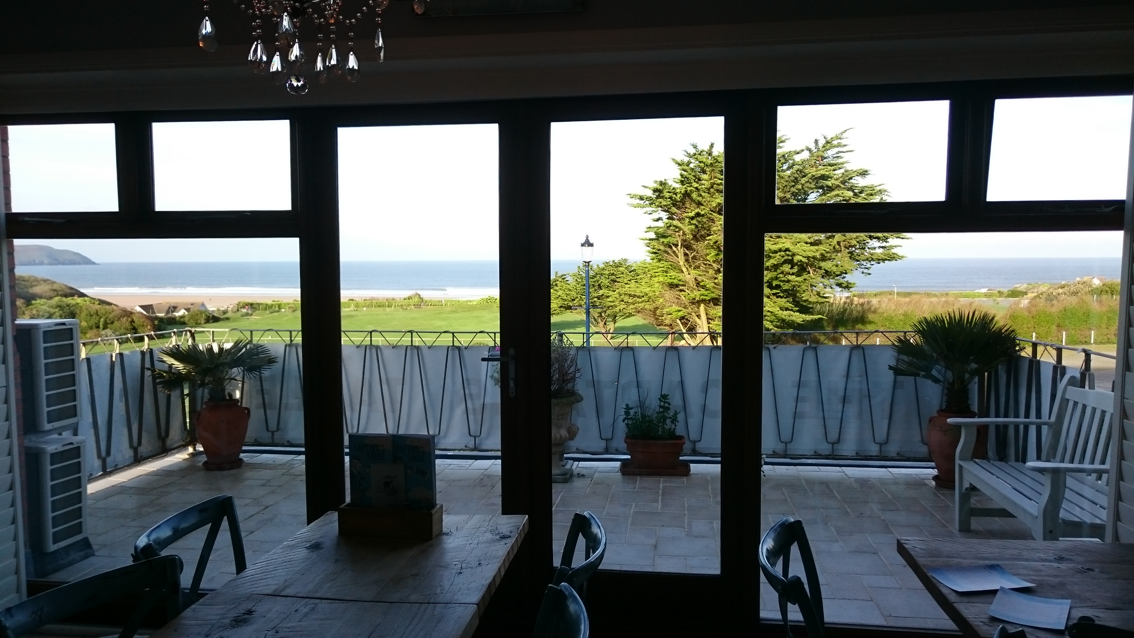 Completed door and window area of this dining area, helping to reduce the glare by 70% from the evening sunset. Tinting Express