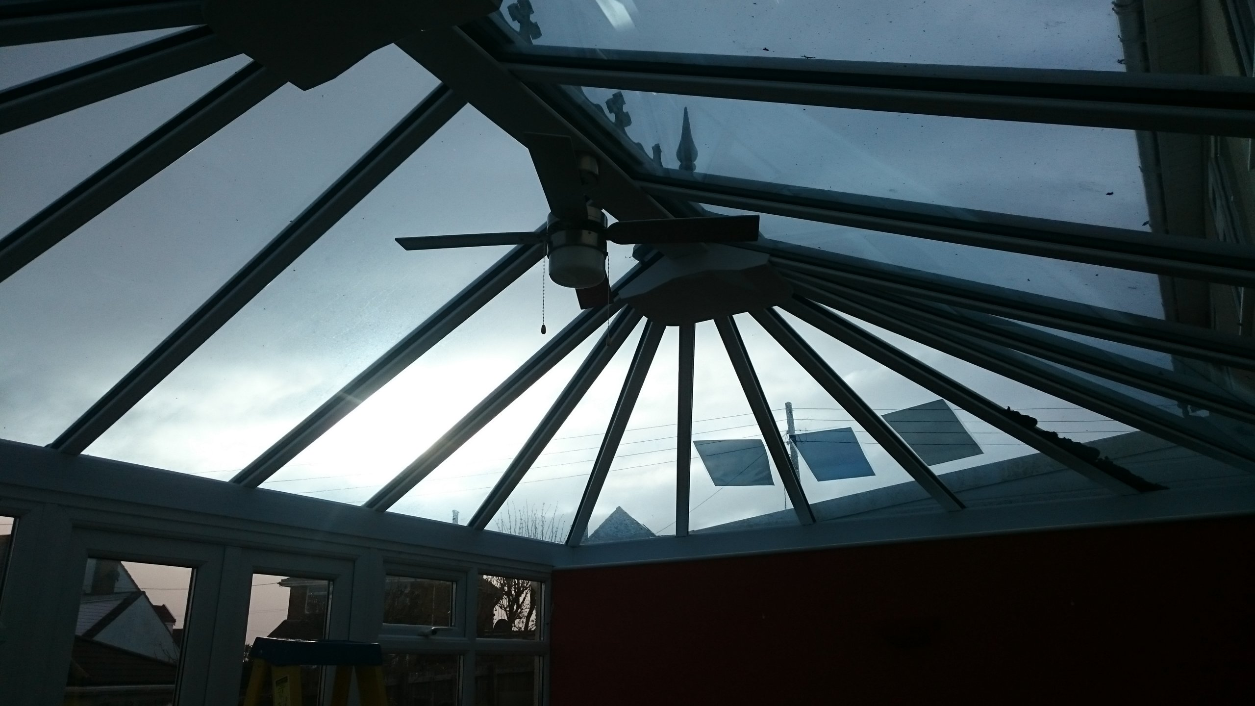 Samples applied to roof glass on conservatory roof awaiting solar window film Dual 15 in Weston Super Mare Somerset . Tinting Express Devon