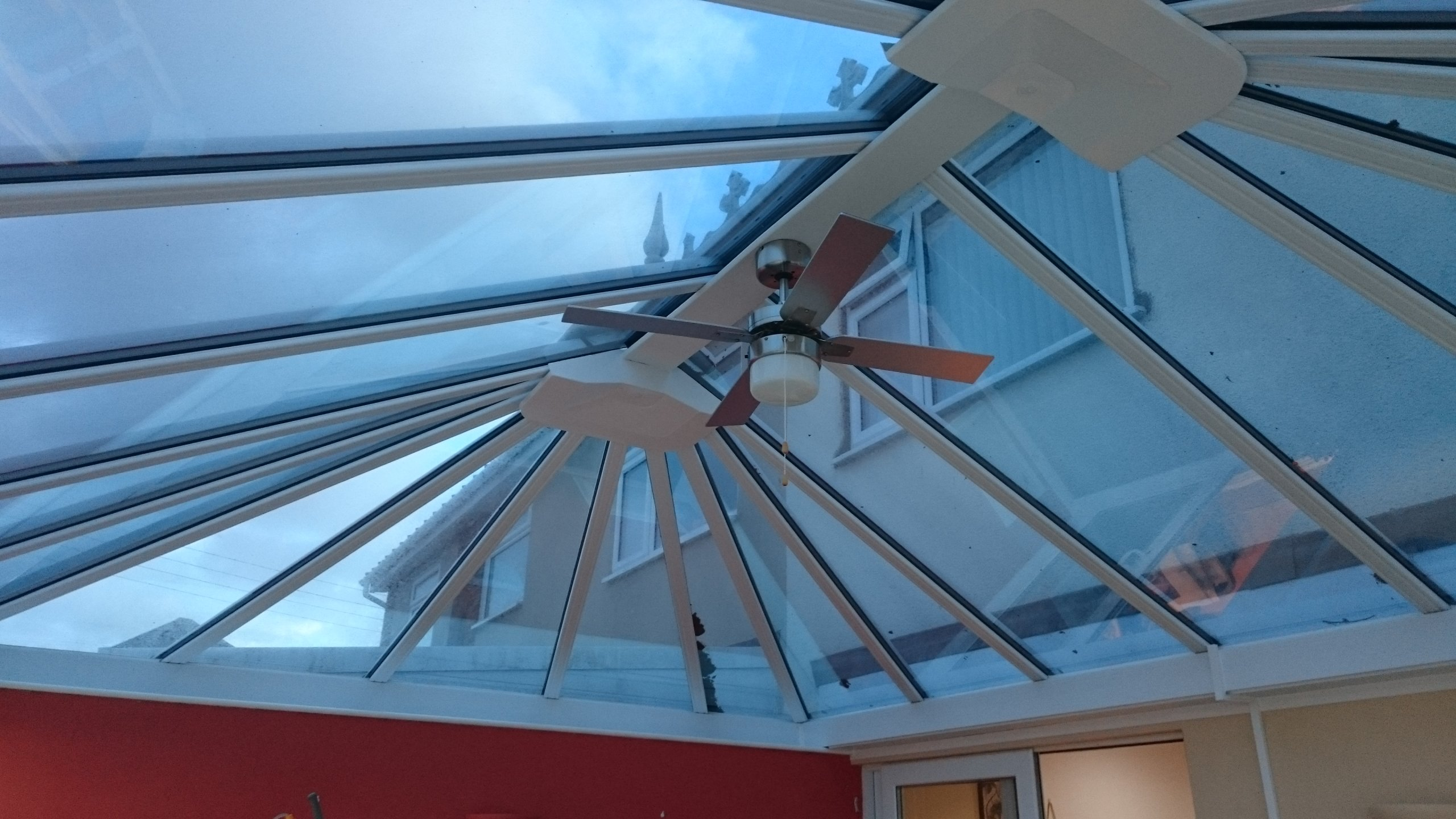 Dual 15 solar window film supplied and fitted to a conservatory roof in Weston-super-Mare. Installation by Tinting Express Barnstaple Devon.
