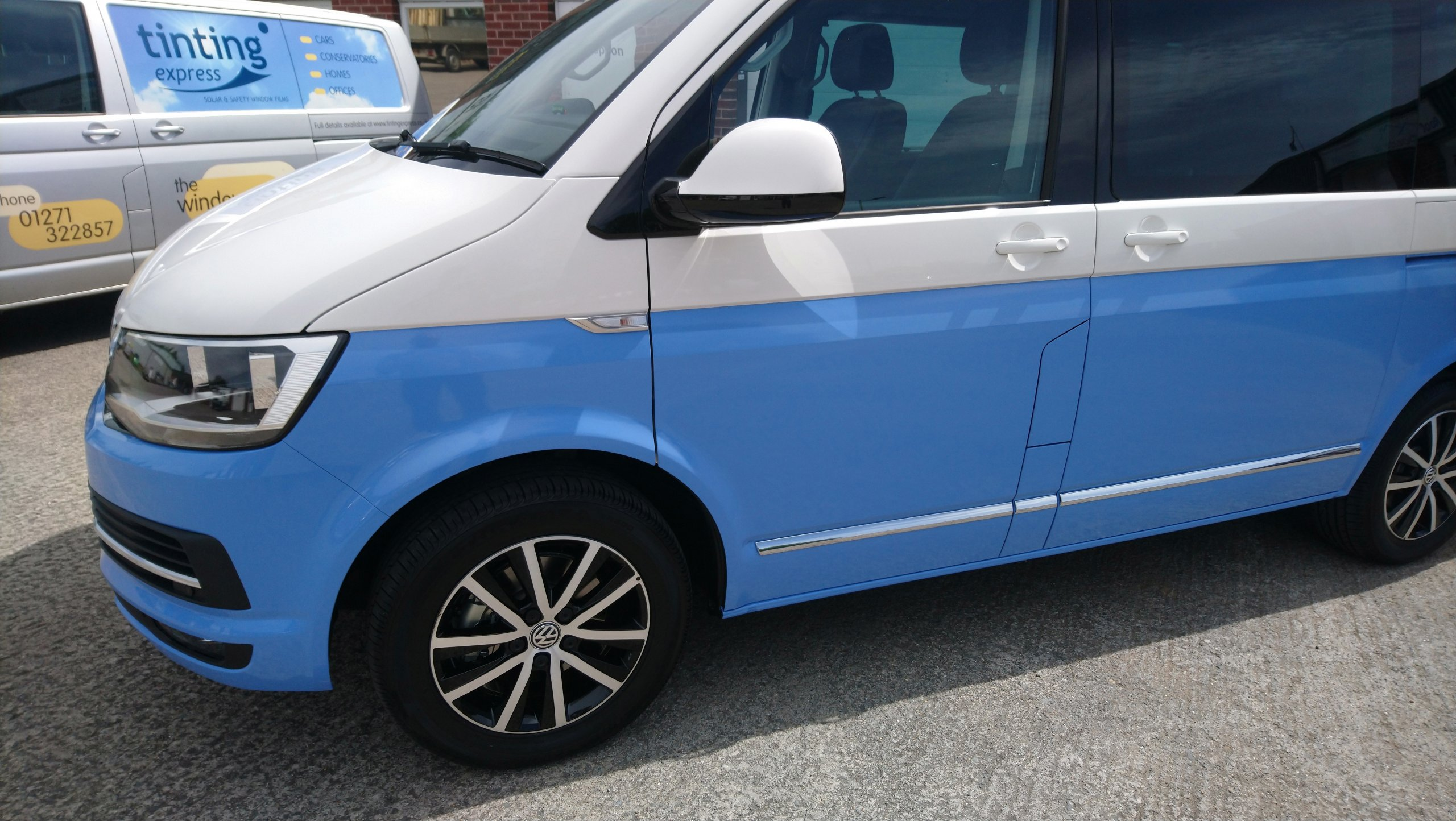 VW T6 Caravelle lower half of van wrapped in a 3M Smokey Blue. Tinting Express Barnstaple