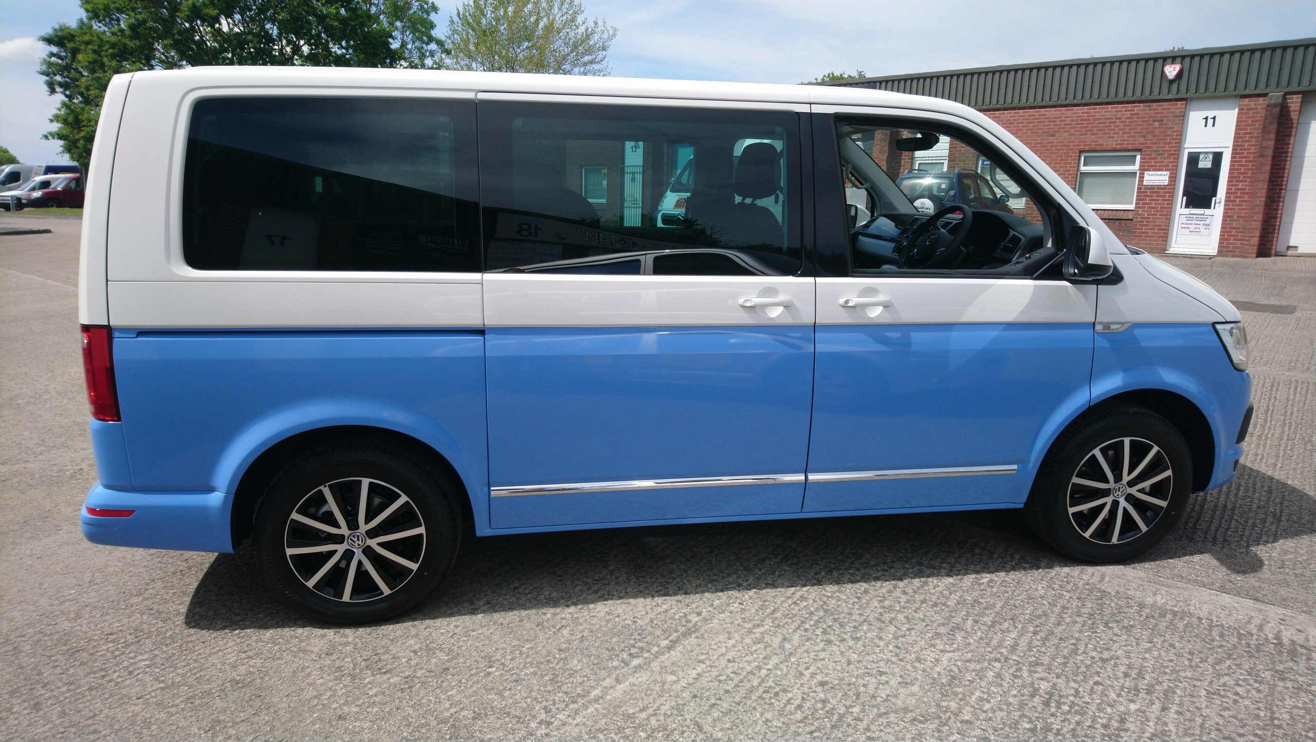 Two toned VW Transporter wrap. Blue added to a white Caravelle to create the two tone effect. 3M Smokey Blue wrap vinyl. Tinting Express Barnstaple