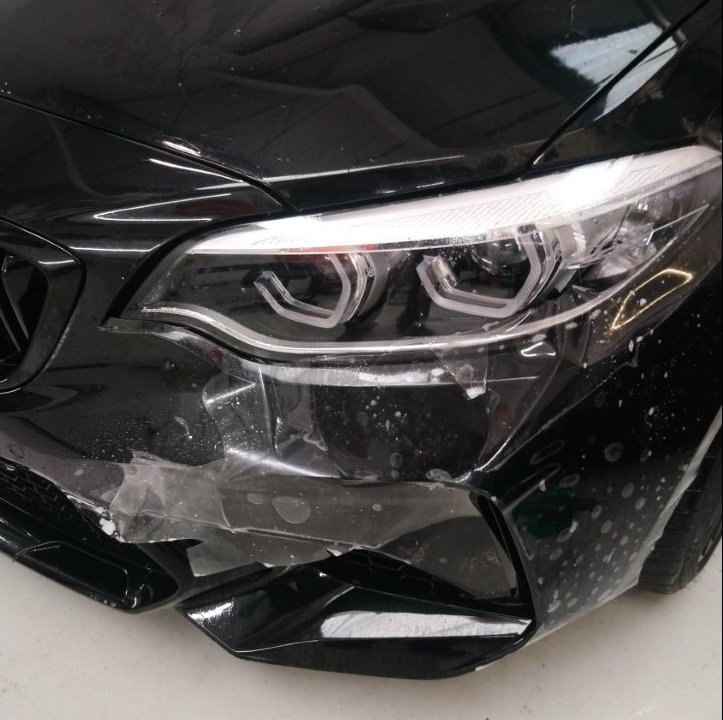 BMW M2 with paint protection film applied to the bonnet and front bumper, providing protection from stone, bird poop and general road debris from damaging the paintwork. Tinting Express Barnstaple Devon