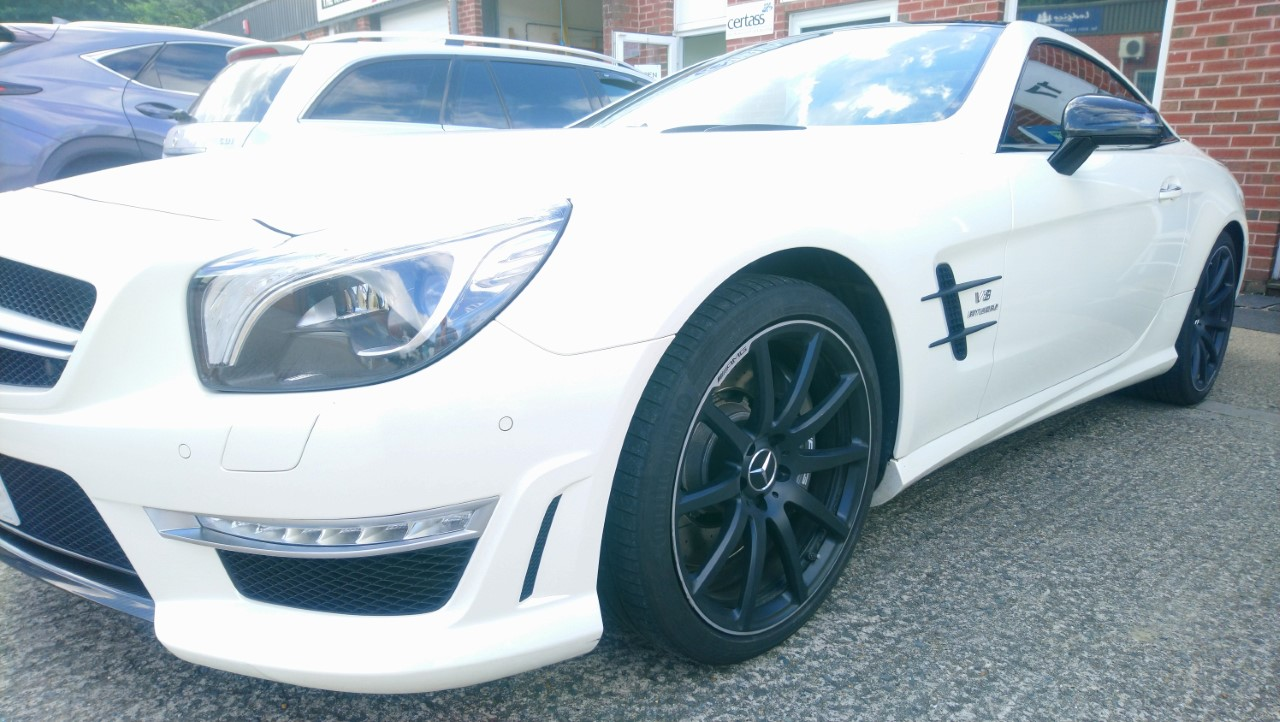 Mercedes SL63 window tints, rear lights, wrap detailing in carbo fibre and gloss black vinyls