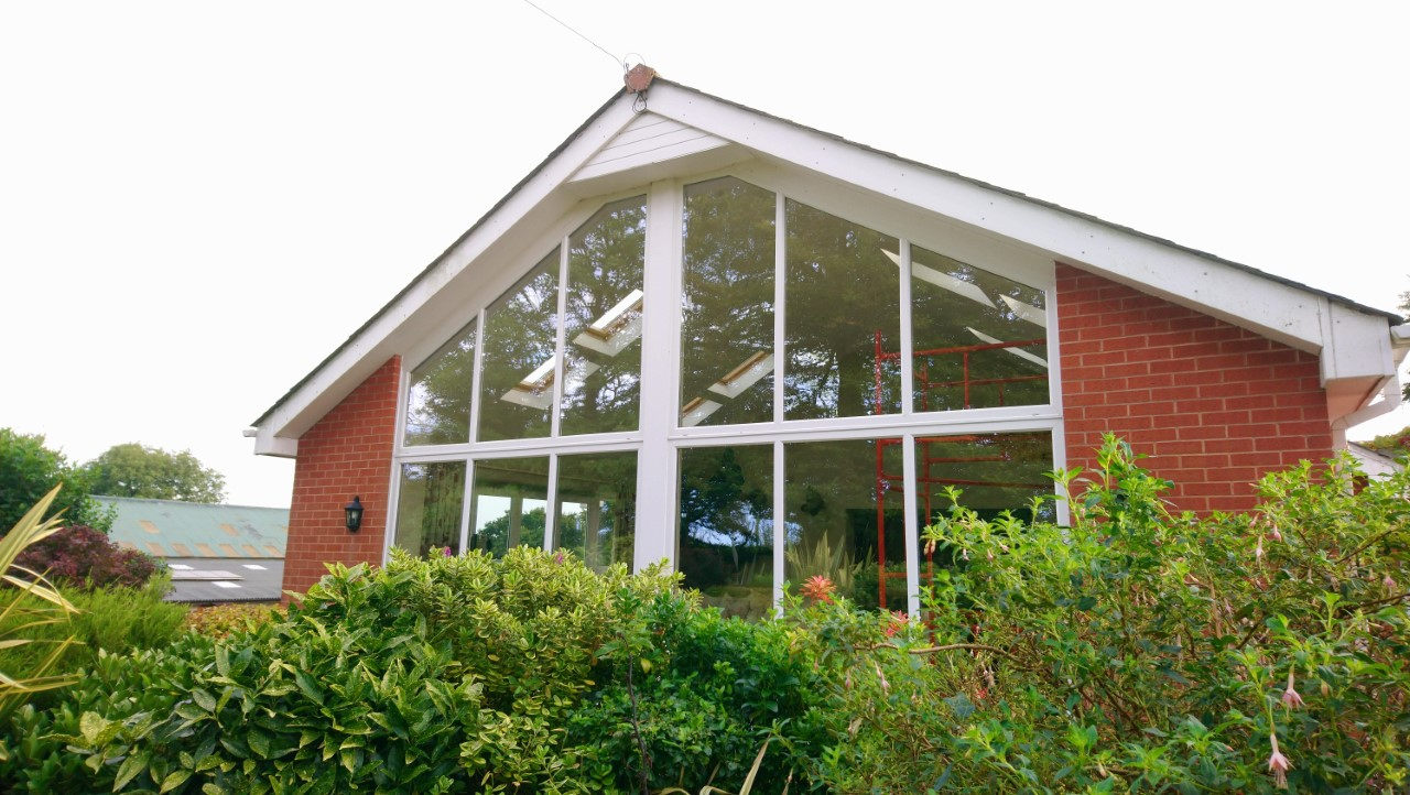 External view before installation. Lounge window and velux skylights having a Dual 10 solar window film applied to reduce sunlight glare. Chulmleigh Mid Devon by Tinting Express Ltd Devon