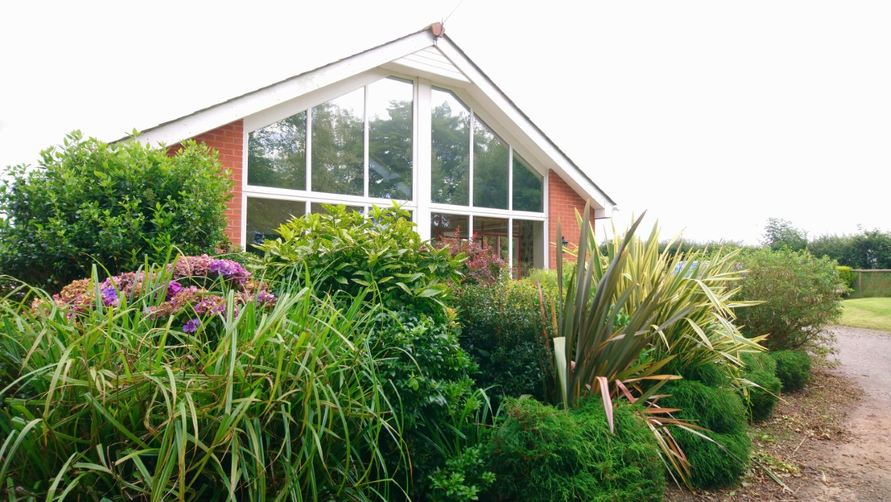 External view. Lounge window and velux skylights having a Dual 10 solar window film applied to reduce sunlight glare. Chulmleigh Mid Devon by Tinting Express Ltd Devon