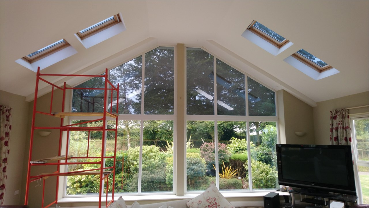 Internal view finished with velux roof lights. Lounge window and velux skylights having a Dual 10 solar window film applied to reduce sunlight glare. Chulmleigh Mid Devon by Tinting Express Ltd Devon