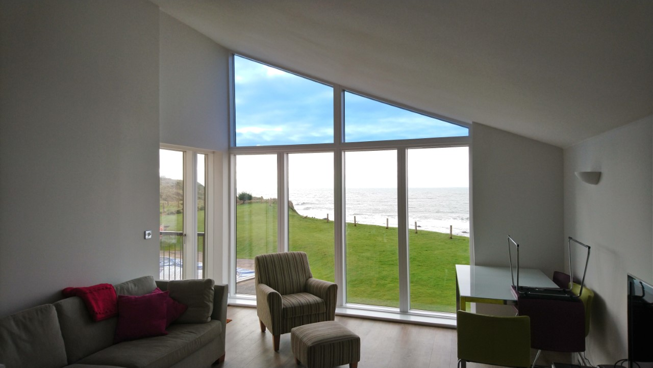 Low Mirror Blue - Light Glare Reduction Film - Gable Window - Thurlestone, South Devon Apartment - Fitted by Tinting Express Ltd