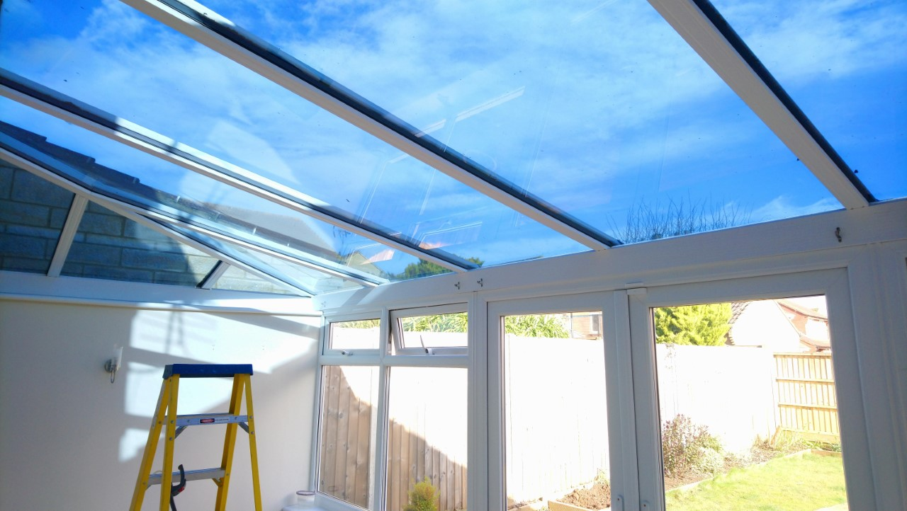 A coating of our solar roof window film Dual 15V on a conservatory in Taunton Somerset by Tinting Express Ltd